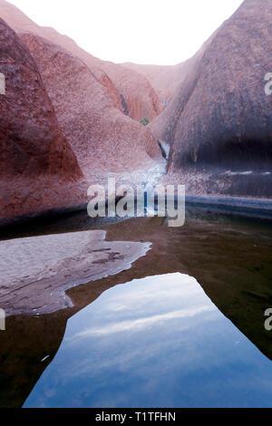 View of Kapi Mutitjulu, Uluru-Kata Tjuta National Park, Lasseter Highway, Uluru NT, Australia - Stock Image