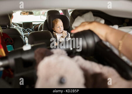 Baby (18-23 months) sitting in car - Stock Image