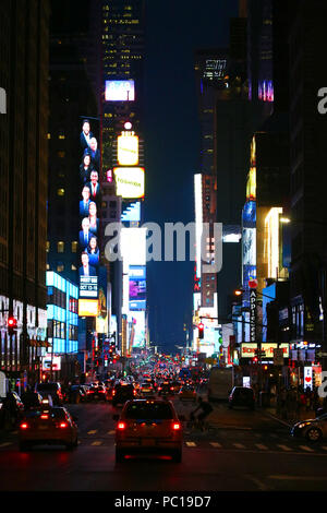 NEW YORK, NY - JULY 11: Broadway Theater District and Times Square neon lights seen south from 7th Avenue in Manhattan on evening JULY 11th, 2017 in N - Stock Image