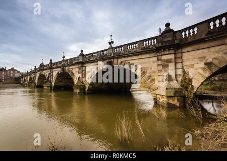 The English Bridge crossing the River Severn in Shrewsbury built from 1774 connecting Wyle Cop with the town centre - Stock Image