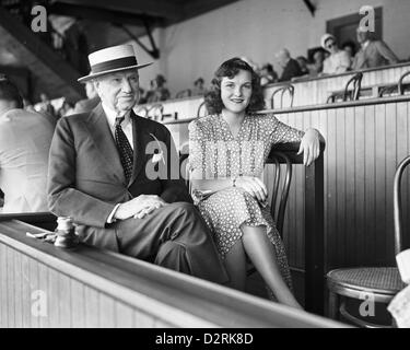 Col. Edward R. Bradley and Beatrice Butler Maguire at Saratoga Race Track, 1941 - Stock Image