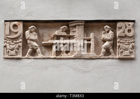 Bas relief sculpture on a building in Haarlem, the Netherlands. It hints that the building it is on was constructed in 1928. - Stock Image