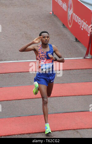 London, UK, 28 April 2019 Mosinet Geremew of Ethiopia. Runners at finishing line of  Virgin London Marathon Credit: JOHNNY ARMSTEAD/Alamy Live News - Stock Image