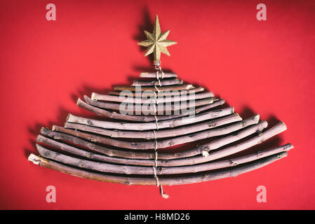 Christmas tree made of wooden branches - Stock Image