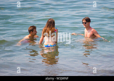 Aberystwyth Wales UK, Tuesday 16 July 2019 UK Weather: Three young friends having fun in the water at the seaside in Aberystwyth on a beautifully warm summers day in west Wales. photo Credit: keith morris/Alamy Live News - Stock Image