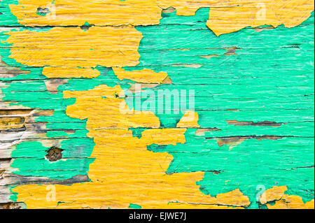 Texture of weathered wood with peeling paint - Stock Image