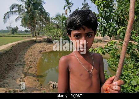 BANGLADESH Girl next to fish pond, Kumargati village, Mymensingh region photo by Sean Sprague - Stock Image