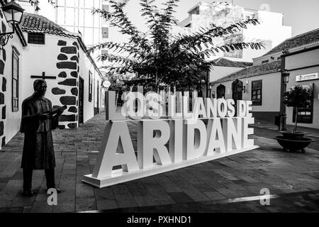 Black and white image of town sign to Los Llanos de Aridane, La Palma, Canary Islands, Spain - Stock Image
