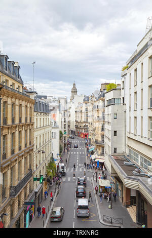 PARIS, FRANCE - JULY 22, 2017: Typical Paris street, high angle view with people and cars in France - Stock Image