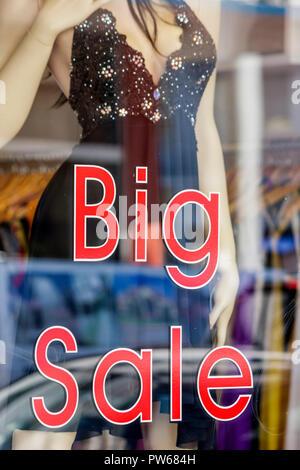 Miami Beach Florida Ocean Drive store boutique shop window clothing fashion female mannequin sign big sale bargain discount ec - Stock Image