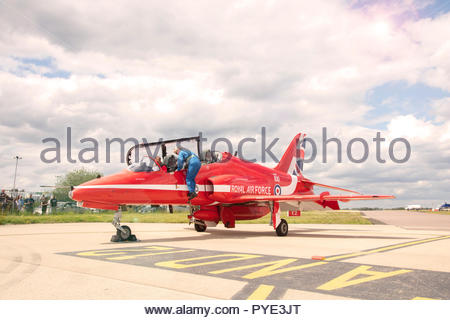 Red Arrows pilot entering cockpit on RAF Scrampton, UK - Stock Image