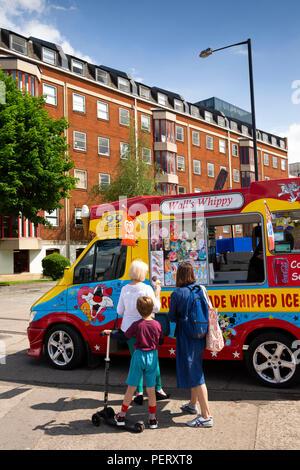 UK, England, Bristol, harbour, Princes Wharf, people at Walls Whippy ice cream van in sunshine - Stock Image