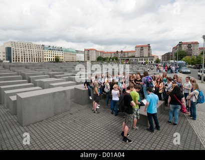 A group of school children being educated about the Holocaust at the Holocaust Memorial in Berlin Germany - Stock Image