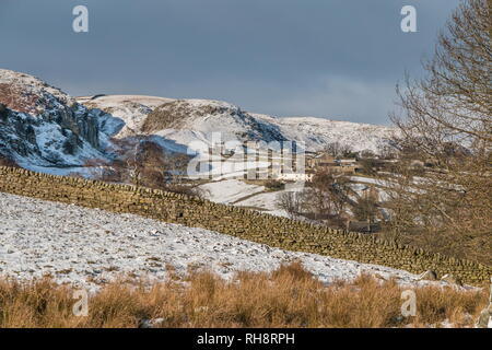 North Pennines AONB Landscape, the rural farming hamlet of Holwick, Teesdale with a covering of snow and January sunshine - Stock Image