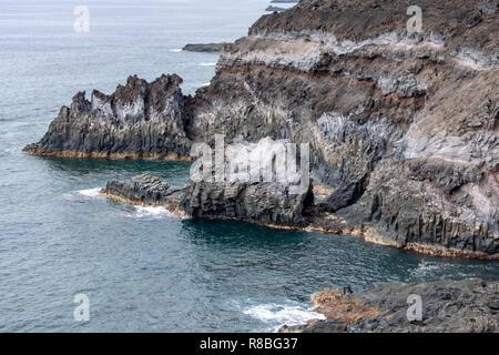 Volcanic basalt columns into the Atlantic Ocean on the coastline of La Palma Island, Canary Islands, Spain - Stock Image