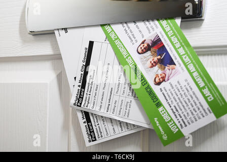 Polling cards for the local council Brighton and Hove City Council elections for Queens Park ward with leaflet from the Green Party 2019 - Stock Image