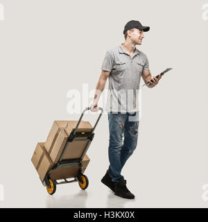 Courier handcart pull boxes and packages - Stock Image