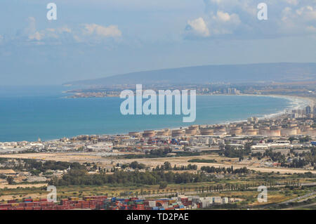 Israel, Haifa, a view of downtown and the bay from the Carmel Mountain. The city of Acre can be seen in the background - Stock Image