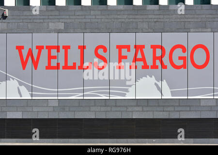 Sign on builders hoarding at new Wells Fargo Bank & Financial Services business office block building European Headquarters City of London England UK - Stock Image