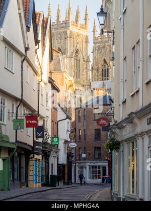 High Petergate a medieval street in the centre of York City towards the Minster in early morning - Stock Image