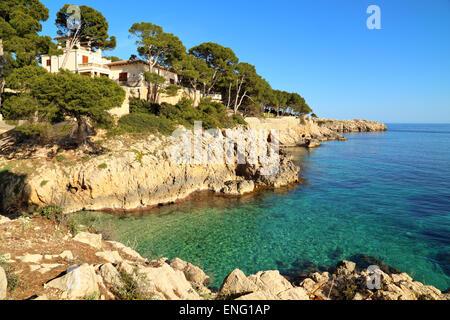 Rocky coast around Platja Cala Gat, Cala Rajada, Mallorca - Stock Image
