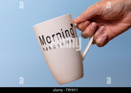 Mug with 'morning handsome' on it. Morning coffee. - Stock Image