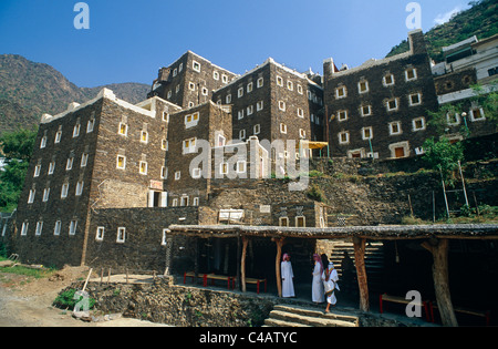 Saudi Arabia, Asir, Rejal- al-amaa. Standing in the Asir Mountains and recently part-restored, the village of Rejal - Stock Image