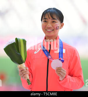 Doha, Qatar. 23rd Apr, 2019. Kora Ayaka of Japan reacts during the victory ceremony of the women's long jump final during 23rd Asian Athletics Championships at Khalifa International Stadium in in Doha, capital of Qatar, April 23, 2019. (Xinhua/Wu Huiwo) Credit: Wu Huiwo/Xinhua/Alamy Live News - Stock Image