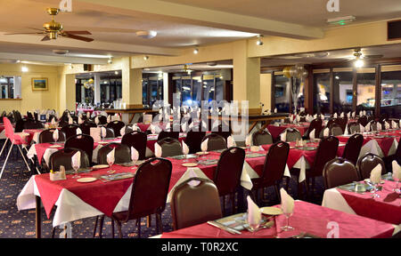 Inside the hotel dining room at Manor House Hotel, Devan, UK - Stock Image