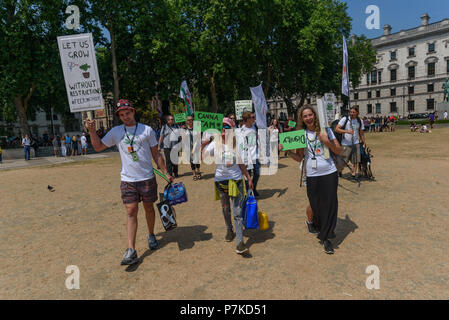 London, UK. 6th July 2018. Members of the group 'We The Undersigned Have a Legal Right to use Cannabis' walk across Parliament Square to protest in Old Palace Yard in support of Newport West Labour MP Paul Flynn's Private Member's Bill to allow the medical use of cannabis was expected to be debated this afternoon. Objections by MPs prevented the debate and it was pushed back until October. Credit: Peter Marshall/Alamy Live News - Stock Image
