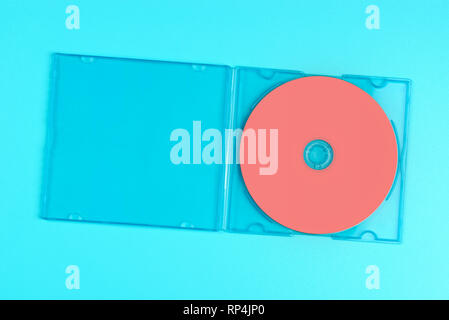 Pastel pink cd in case on pastel blue background. Color of the year 2019 - Living Coral. - Stock Image