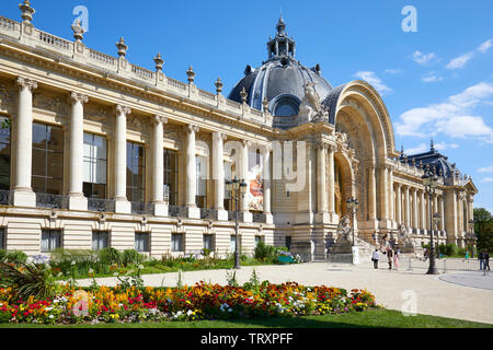 PARIS, FRANCE - JULY 21, 2017: Petit Palais building and colorful flowerbed in a sunny summer day, clear blue sky in Paris, France. - Stock Image