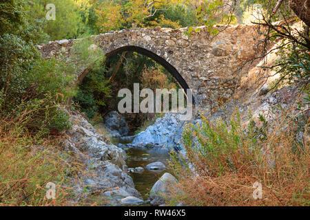 Gefiri Treis Elies Venetian pack horse bridge over a river in the Troodos mountains, Cyprus 2010 - Stock Image