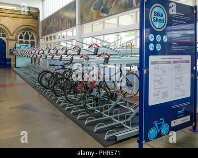 The Bike Shed a secure storage area for bicycles in plain view in the Middlesbrough Train Station building for safe storage of bicycles for passengers - Stock Image