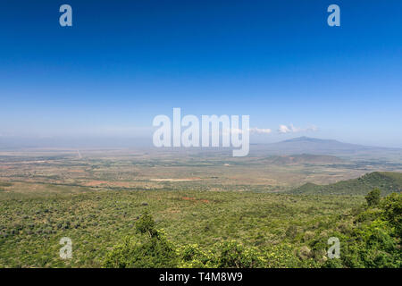 Rift Valley view from teh escarpment with Mount Longonot in the distance, Kenya - Stock Image