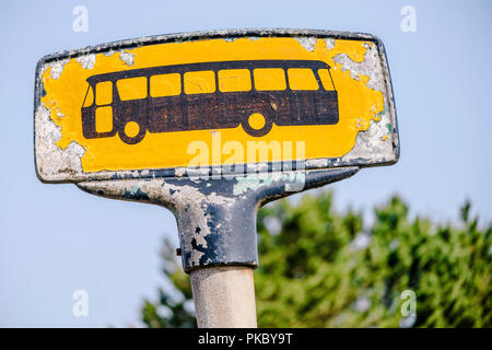 Yellow bus stop sign with a rough look in yellow colors - Stock Image