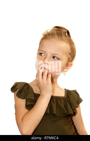 A six year old girl appears thoughtful - Stock Image