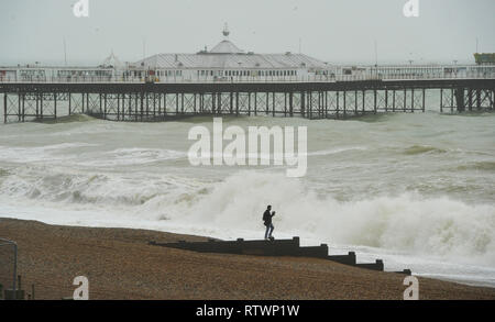 Brighton, East Sussex, UK. 3rd March 2019 .A visitor gets a close look at the sea in Brighton as Storm Freya batters parts of Britain today Credit: Simon Dack/Alamy Live News - Stock Image