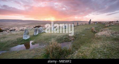 Sunset at scorhill bronze age stone circle Dartmoor National Park Devon Uk - Stock Image