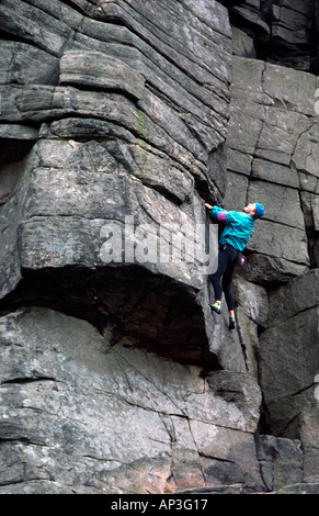 climber Mark Elliot rock climbing on Stanage Peak District National Park Derbyshire - Stock Image
