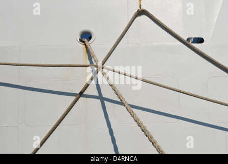 ropes hanging from ship - Stock Image