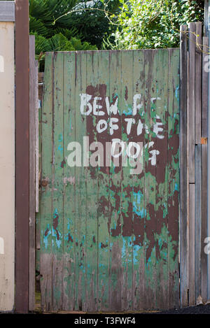 A hand painted Beware of the dog sign on a timber gate in a back street of  the Sydney suburb of Surry Hills, NSW Australia - Stock Image