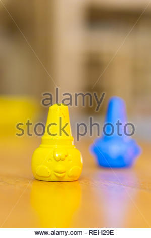 Poznan, Poland - October 10, 2018: Yellow chicken shaped crayon standing on a wooden floor in soft focus - Stock Image