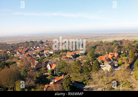 A view over Blakeney village towards the salt marshes and Blakeney Point from the Church tower at Blakeney, Norfolk, England, United Kingdom, Europe. - Stock Image