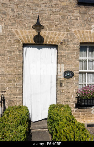 White door cover to prevent paint blistering in hot sun - Stock Image