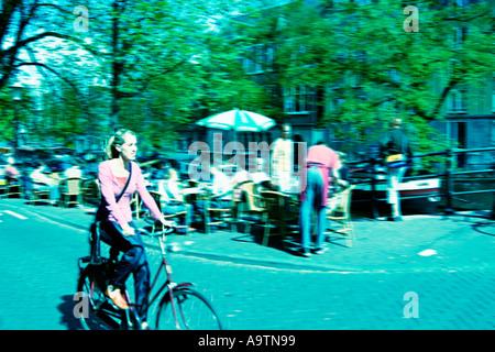 Amsterdam Jourdan woman on bicycle cross style - Stock Image