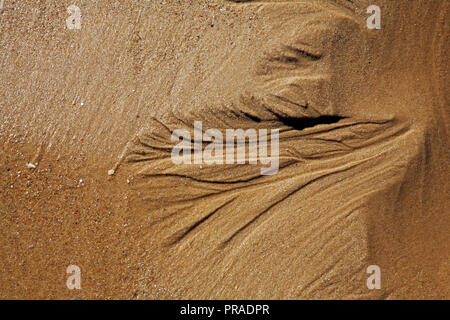 A close-up view of sand patterns on a North Norfolk beach at East Runton, Norfolk, England, United Kingdom, Europe. - Stock Image