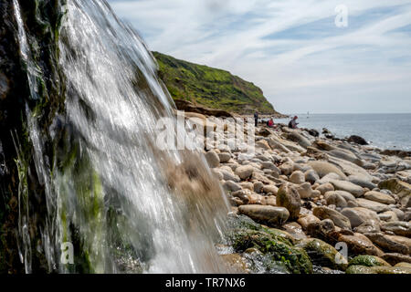 Water outflow on the beach at Osmington Dorset - Stock Image