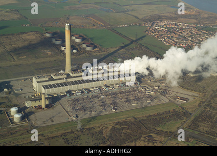 Aerial view of steam escaping fom the power station on the Isle of Grain in Kent. Also featured is the 400kV Substation - Stock Image