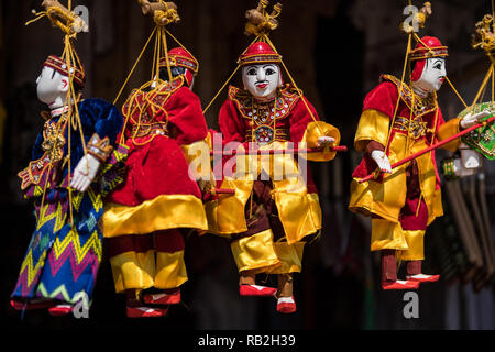 Colourful traditional marionettes on sale in Bagan, Myanmar - Stock Image